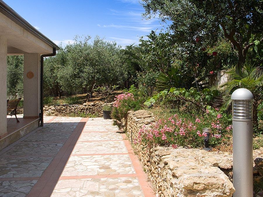 In the garden of holiday home Villa Ponzini in Trappeto in Sicily