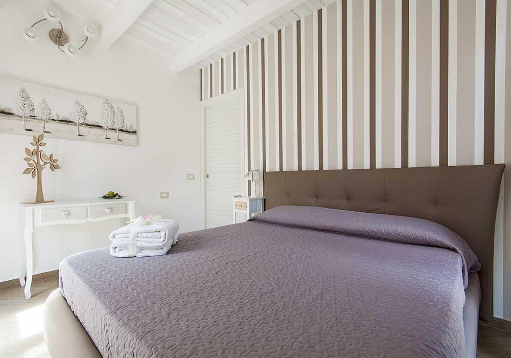 De eerste slaapkamer van Appartamento Barcuni